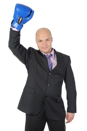Businessman with boxing gloves raised his hand. Isolated on white background photo