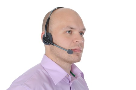 helpdesk: man with a headset isolated on white background Stock Photo