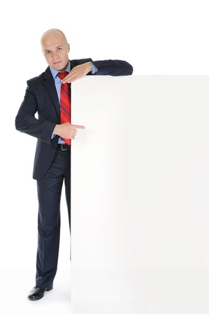 Businessman in black suit with large blank. Isolated on white background photo