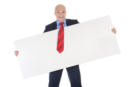 Young smiling businessman in black suit holding large blank. Isolated on white background Stock Photo - 8061561