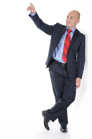 Businessman in full-length standing against a wall in a bright room. Isolated on white background photo