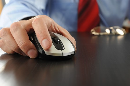 Image of a computer mouse in hand businessman photo