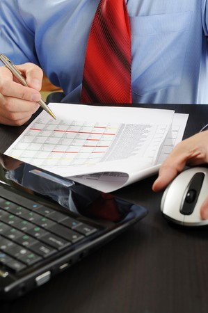 Image of a businessman working with documents in the office of the table Stock Photo - 8061650