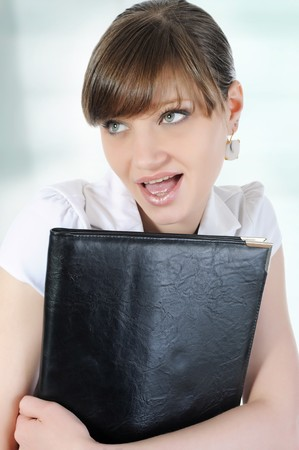 Portrait of beautiful business woman with a folder in hand.  photo