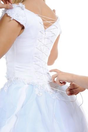 Silk white corset bride. Isolated on white background photo