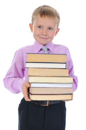 happy boy holds a stack of books. Isolated on white background photo