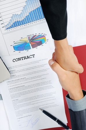 Handshake of business partners, when signing contract. Stock Photo - 8061652