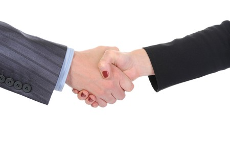 Handshake of business partners, men and women in the office. Isolated on white background photo