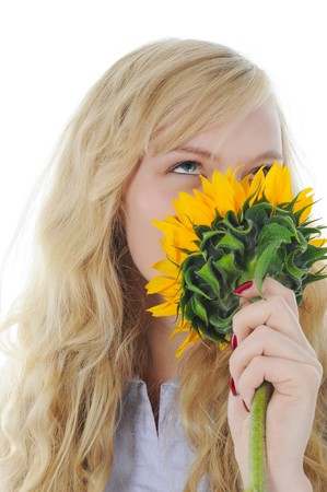 Image of a charming young blonde sniffs sunflower. Isolated on white background photo