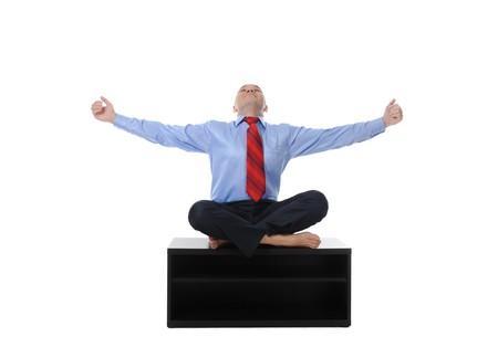 businessman meditating in yoga lotus. Isolated on white background photo