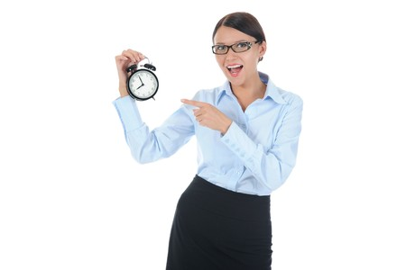 businesswoman with an alarm clock in a hand. Isolated on white background photo