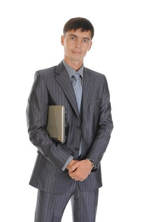Businessman holding laptop. Isolated on white background photo