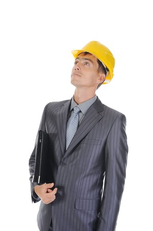 Portrait of a young businessman in the construction helmet, looking up. Isolated on white background Stock Photo - 8061705