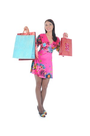 beautiful young woman in a full-length with shopping bags. Isolated on white background photo