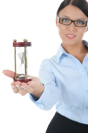 Portrait of a young businesswoman with an hourglass in his hand. Isolated on white background Stock Photo - 8061674