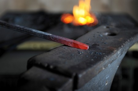 smithy: decorative incandescent pattern in the smithy on the anvil