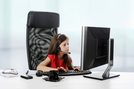 girl with astonishment looks in the monitor.  photo