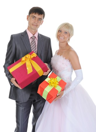 Newlyweds with gift boxes in their hands. Isolated on white background Stock Photo - 8061853