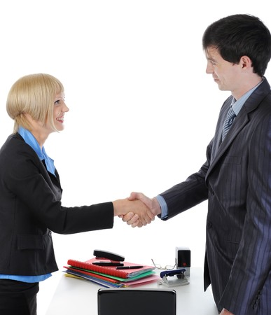handshake happy business partners in the office. Isolated on white background photo