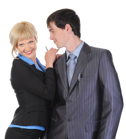 Beautiful blonde woman hugging a man in the suit. Isolated on white background photo