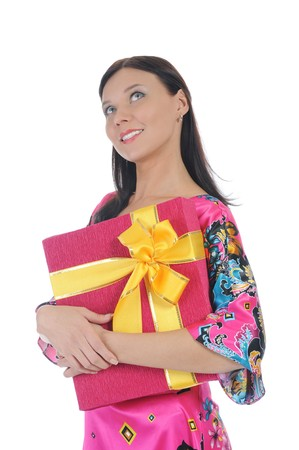 Long-haired brunette in pink dress with a gift box. Isolated on white background Stock Photo - 8061866