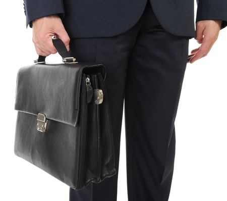 Image of a businessman holding a briefcase. Isolated on white background Stock Photo - 8061934