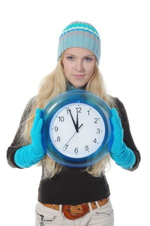 Young blonde woman in winter clothes with a clock in his hands. Isolated on white background photo