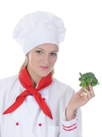 mujer con corbata: Retrato de un cocinero feliz con las coles de Bruselas en su mano. Aislados en fondo blanco  Foto de archivo