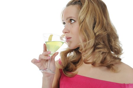 The blue-eyed girl with a martini glass in a hand. Isolated on white background photo