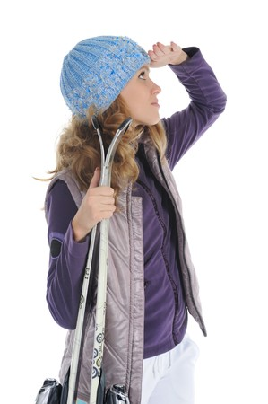 Beautiful skier looks into the distance. Isolated on white background photo
