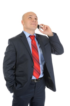image of a businessman in a black suit with red tie, talking on the phone. Isolated on white background photo