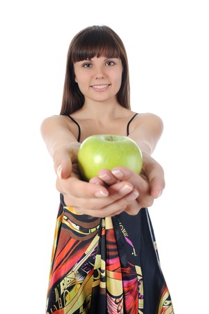 Athletic girl holding a green apple in hand. Isolated on white background Stock Photo - 8061949
