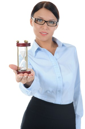 Portrait of a young businesswoman with an hourglass in his hand. Isolated on white background photo