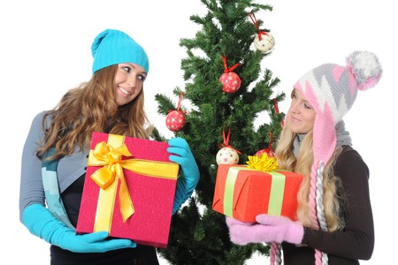 Image of two young women adorn the Christmas tree toys. Isolated on white background Stock Photo - 8062002