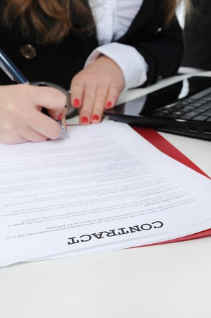 Image of business woman signing a contract photo