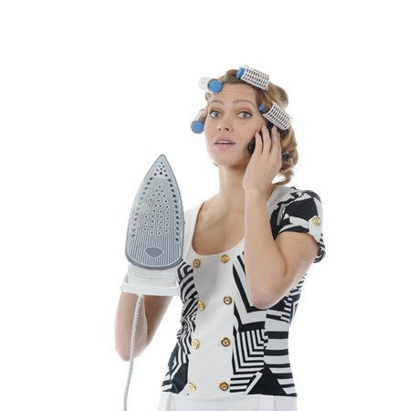 Young woman with curlers on her head talking on the phone.  Isolated on white background photo
