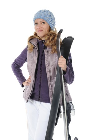 Beautiful skier holding ski in the hands. Isolated on white background photo