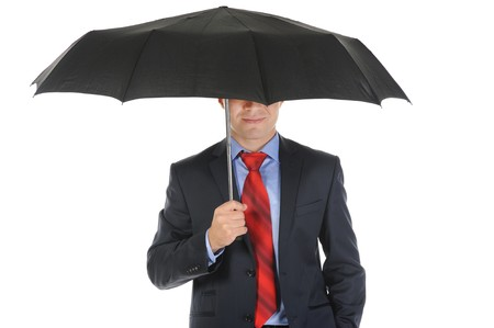 Image of a businessman with umbrella. Isolated on white background photo