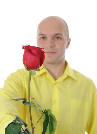 Picture a man in a yellow shirt holding a red rose. Isolated on white background photo