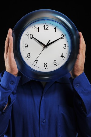man in a dark blue shirt holds hours in the face of photo