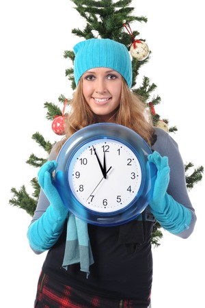 Young woman in winter clothes with a clock in his hands. Isolated on white background photo