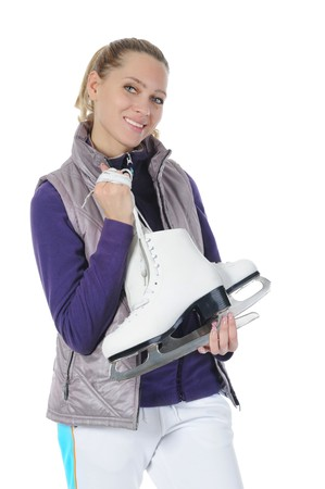 Young smiling woman with skates in studio. Isolated on white background photo