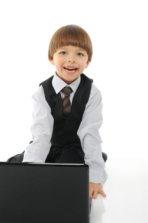 little boy with a laptop. Isolated on white background photo