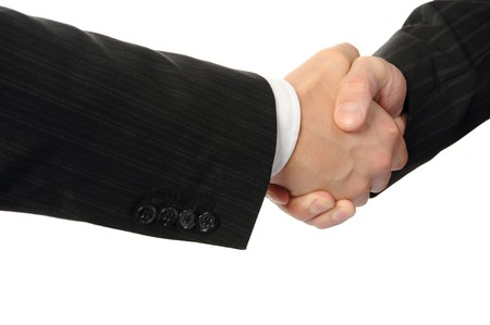 Handshake two business partners. Isolated on white Stock Photo - 8133724