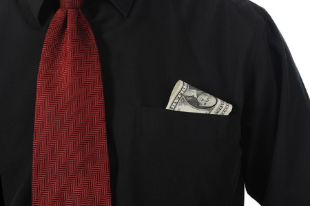 dollar bill into a shirt pocket businessman Stock Photo - 8162778
