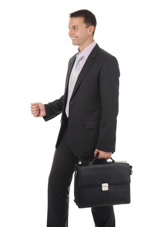 Businessman with briefcase in hand. Isolated on white background photo