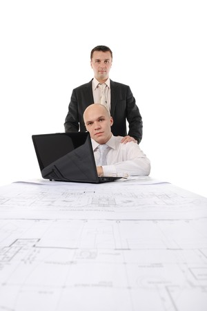 two businessmen in a business suit at a table in a bright office. Isolated on white background Stock Photo - 8172507