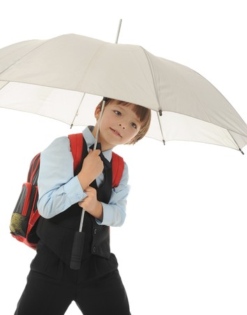 Schoolboy with a umbrella. Isolated on white background photo