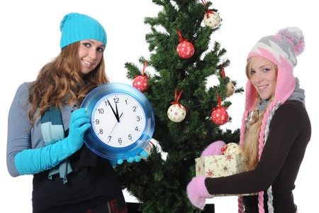 Young women in winter clothes with a clock in his hands. Isolated on white background photo