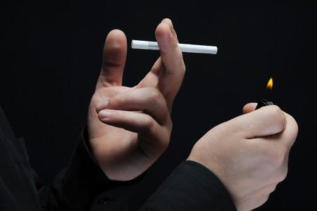 smokes a cigarette on a dark background photo